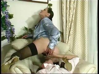Mature in satin blouse seduces him
