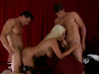 Slut Bridgette B gets spit roasted by a couple dicks