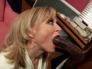 Slutty Nina Hartley with a black stud