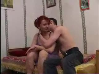 Milf redhead enjoys the young man cock