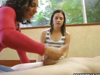 Dirty slut Brandi Belle watching her sexy friend get a load of jizz in her hands