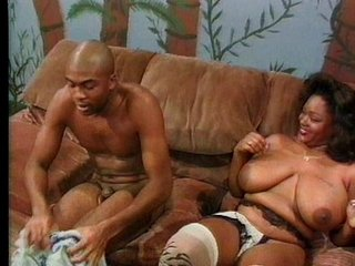 Busty ebony babe knows how to suck