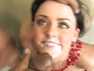 Sophie Dee gets her face blasted with hot jizz