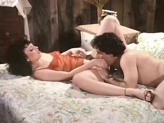 John Leslie eats a sassy brunette's pussy