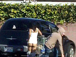 Pervert Guy runs up and pulls some radom lady's shorts down in the supermarket parking lot...