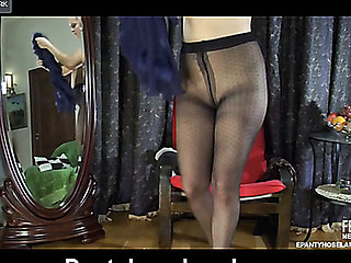 Pretty playgirl trying on tights of different colors and style by the mirror
