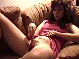 My husband has filmed me while I explore my own hairy pussy on the couch. With my legs spread, I slowly but sensually rub snatch with a sex toys. I feel my husband's eyes on me and it turn me on.