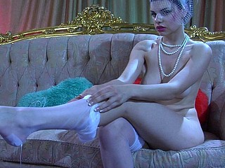 Dressed in vintage style hottie slowly rolls down her white satin top nylons