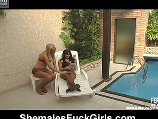 Nasty chick opening her legs for vigorous fucking with shemale on lounge