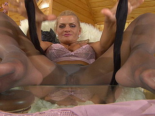Masturbating blond settles for darker crotchless hose smeared in her juice