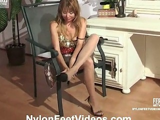 Lascivious chick in shiny open toe hose giving mind-blowing footjob