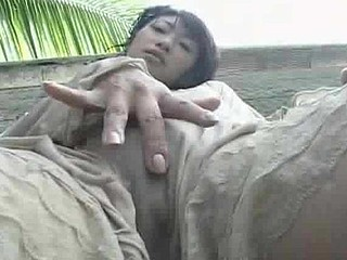 Kyoka in a garden fondling her bazookas and wet crack then rubs her cum-hole on a pole.