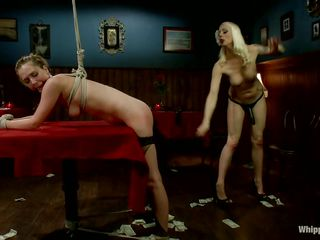 Blonde mistress Lorelei is whipping that ass! Her chick, Star, is tied and bent over on the table. Lorelei whips her booty hard and makes her slut girl moan with pleasure. She then straps on a dildo and begins drilling her wet, juicy pussy from behind. Like it until here? Then stick around and watch some more!