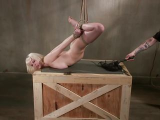 She's tied and hanged but not to high because her big boobs are still touching that wooden box. At first the executor whips her tight cunt and then spanks it with precision, making every strike a moment of pleasure and pain for her. Take a look at that pretty face, it's clear that she's confused with herself!