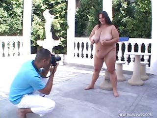 The shutter of the camera clicked non-stop for the plus sized model. Totally naked with her big breasts hanging, she tried various poses for the photographer's lens. After their session, the young man taking her pictures just had to strip and demand for her to rub his dick using her glorious tits!