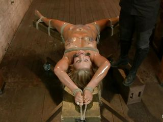 Blonde slut Cameron is all tied up with strings to a wooden table and mouth gagged. With her legs spread, she gets fingered and has a vibrator on her clitoris. Let`s take a close look at that hot oiled up body and with wax all over her! Will her mistress make that whore cum if her cunt gets fisted so hard?
