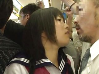 Horny little schoolgirl is in a crowded public transportation. The older man in front of her makes her act like slut because he has an erection ans she feels it through her short skirt. The bitch has the courage to kiss him and loves it. Soon our Nippon cutie starts acting like a slut and salivates at his dick