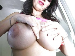 Watch this sexy brunette who is here to show her nice big boobs for all those natural tit lovers. She takes those tits out and starts touching & squeezing them with both of her hands. She also does a teasing with that nice ass of hers. And then again she starts playing with those tits and kisses at the screen!