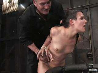 The old, experienced executor is showing this young cutie what he is capable of. He tied her hands and legs and grabbed her by the neck so he could put her head under water. She is wet and dominated and looks like this slut enjoys her situation a lot, especially when he slaps her ass and uses a vibrator to stimulate her clit.