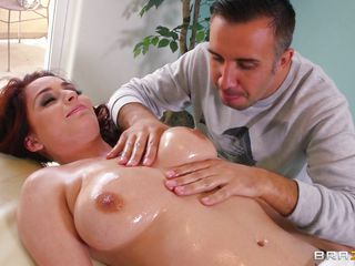 Ashley Graham is oiled up and ready to go. When laying eyes on this busty redhead, tattooed beauty, Keiran just can't help himself and an innocent massage turns into hot foreplay. Watch him as he fondles those gorgeous tits and licks the hell out of her pretty pink pussy!