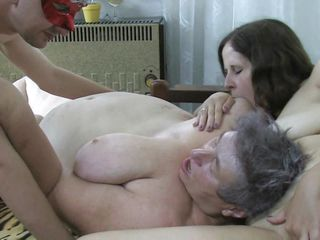 Fat old slut Eva is in bed with a bbw and a horny guy. The old whore can handle a threesome fuck just as good as her younger girlfriend. Her huge saggy boobs are being licked and her cunt gaped. Look at her, so big and lustful, it makes you wonder how much cum it's needed to satisfy this granny