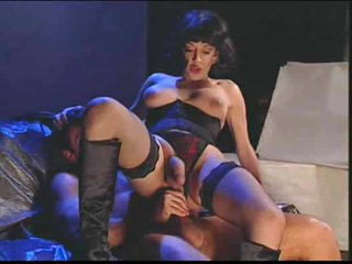 Shemale in boots and stockings fucked